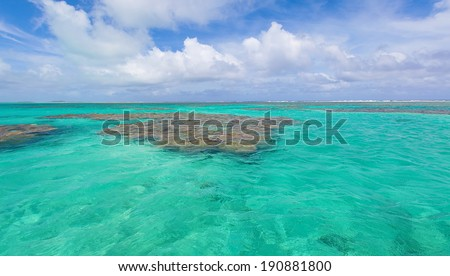 view at beautiful turquoise lagoon at cook islands, aitutaki - stock photo