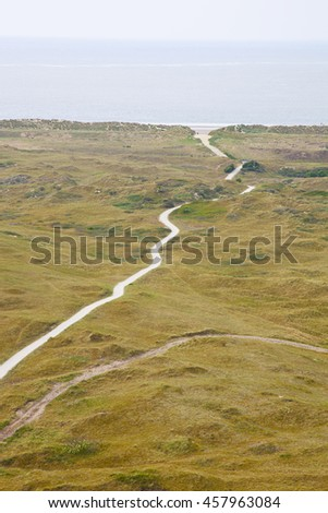 View at dunes and sea in Ameland, The Netherlands - stock photo