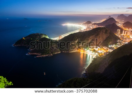 View at dusk from the top of the Sugar Loaf, Rio de Janeiro, Brazil - stock photo