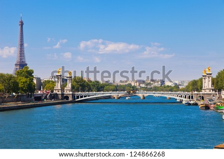 View at Eiffel Tower and one of bridges in Paris - stock photo