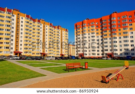 view at modern courtyard between apartment buildings - stock photo