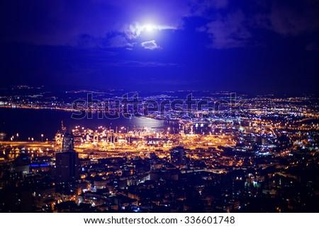 View at night from Mount Carmel to Haifa Port in Israel. Mediterranean Sea - stock photo