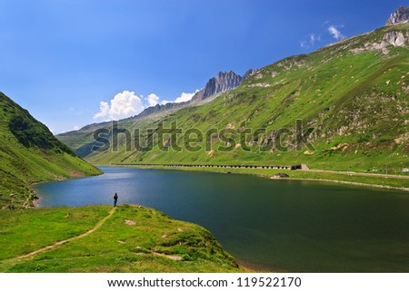 View at Oberalpsee (lake) from famous Oberalp Pass (el. 2044  m), Switzerland - stock photo