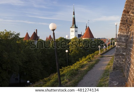 View at old Tallinn towers from upper town, Toompea, at sunny spring afternoon