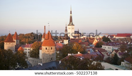 View at old town towers at autumn at golden hour. Panorama, photographed in Tallinn, Estonia, Europe