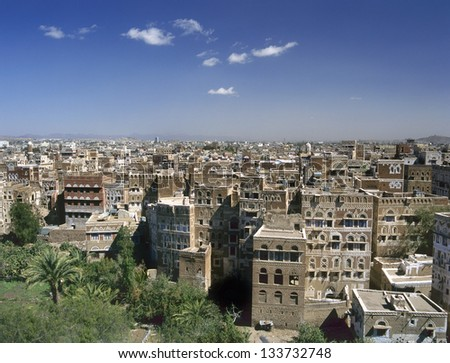 View at Sana'a the capital of Yemen.At the foreground palms and a small garden. - stock photo