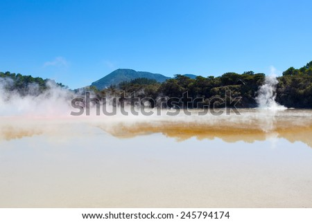 view at steaming hot springs in wai-o-tapu geothermal area in new zealand - stock photo