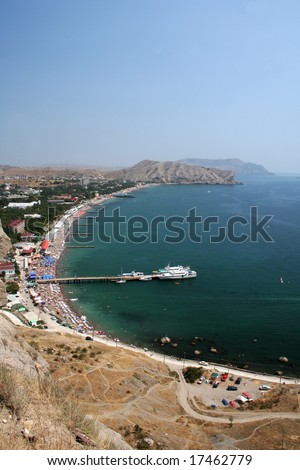 View at Sudak city on Crimea Ukraine with beach and gulf