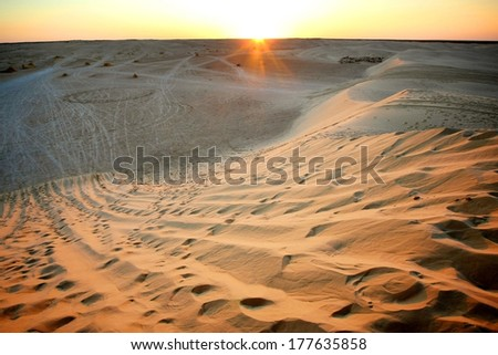 View at sunset on the dunes of Ong Jemel in the Sahara Desert in Tunisia. - stock photo