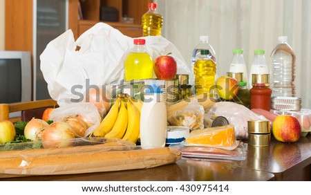 View at table with articles of food for small family - stock photo