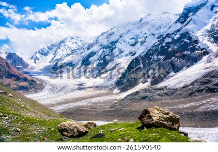 View at the big snowy Greater Caucasus Mountain Range. Picture was taken during a trekking hike in the magnificent and stunning mountains of Caucasia at summer,Bezengi region,Kabardino-Balkaria,Russia - stock photo