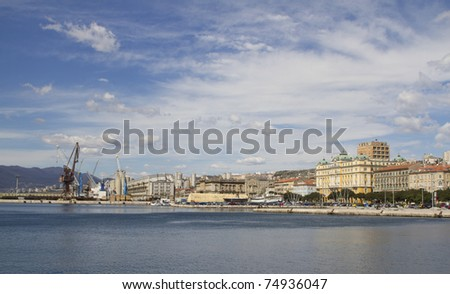 View at the buildings and port in Rijeka, Croatia from promenade in harbor - stock photo