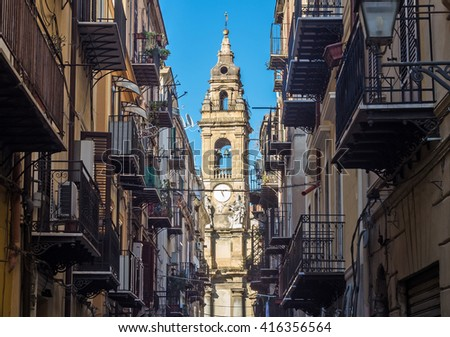 View at the church of San Ignazio all'olivella located in heart of Palermo, Italy, Europe; traditional Italian medieval city center with typical narrow residential street. - stock photo