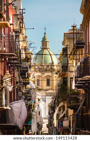 View at the church of San Matteo located in heart of Palermo, Italy, Europe;  traditional Italian medieval city center with typical narrow residential street. - stock photo