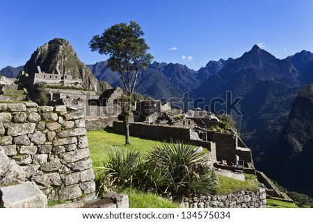 View at the lost Inca city Machu Picchu with the Huayna Picchu mountain in the back - Andes - Peru - South America