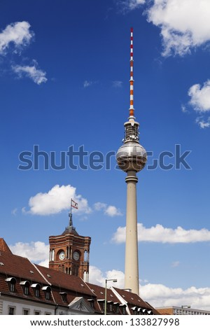 View at the world famous Berlin television tower rising behind buildings. - stock photo