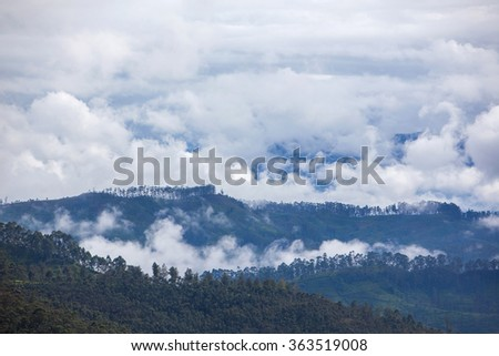 View at valley on cloudy morning from Adam's peak - Sri Lanka - stock photo