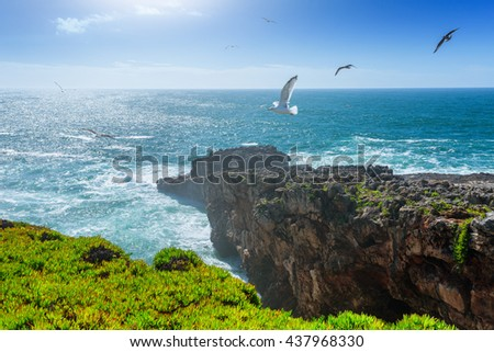 "View cliffs near cavern ""Boca do Inferno"", Cascais, Portugal. Beauty in nature. the Atlantic ocean. Beautiful marine landscape in backlit. - stock photo"