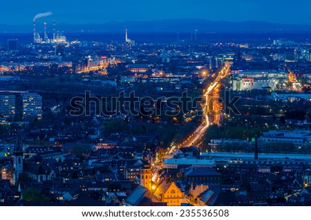 View down on a street with many lights winding through a city  - stock photo