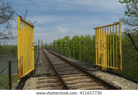 View down the tracks with La Salle Rail Bridge in background on a Spring morning.  La Salle, Illinois, U.S.A.. - stock photo