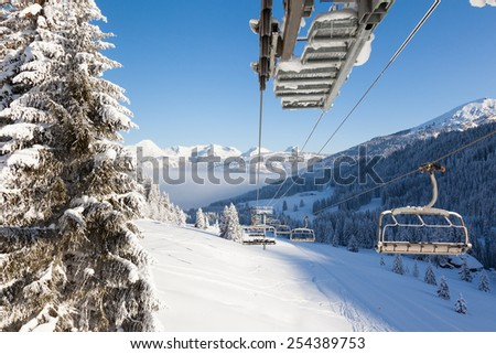 View down the valley from a chair lift in Les Gets ski resort, Portes Du Soleil, France