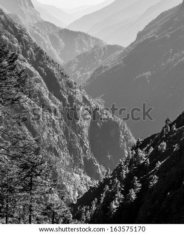 View down the valley of the Dudh Koshi Nadi - Everest region, Nepal, Himalayas (black and white) - stock photo