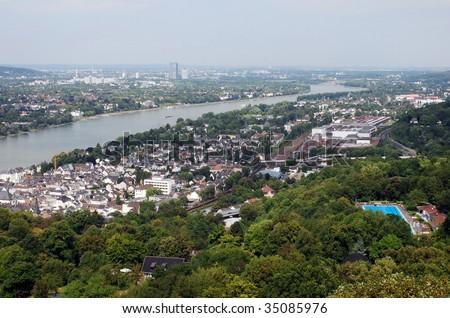 View downstream River Rhine overlooking Koenigswinter, Bad Godesberg & Bonn from North Tower, Schloss Drachenburg - stock photo