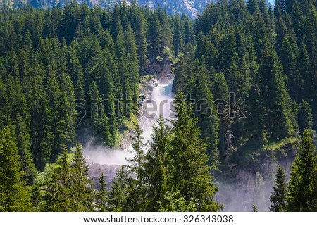 View far, away beauty Alpine inspiring Krimml waterfall in mountains, blue sky, deep rich green forest, spruce, trees. summer day. trekking in National park Hohe Tauern, Austria, Europe. Poster Image - stock photo
