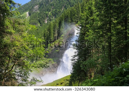 View far beauty Alpine inspiring Krimml waterfall in mountains, clear blue sky, deep rich green forest, spruce, trees. summer day. trekking in National park Hohe Tauern, Austria, Europe. Poster Image - stock photo
