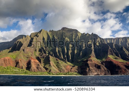 View from a boat towards the famous Na Pali Coast on the northern coast of Kauai, Hawaii, USA.