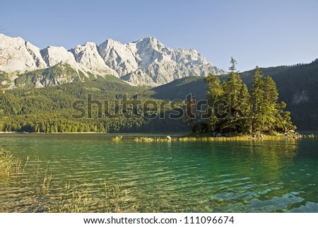 view from a lake to the mountain massif