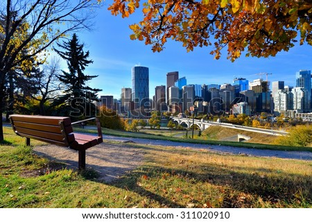 View from a park overlooking the skyline of Calgary, Alberta during autumn - stock photo