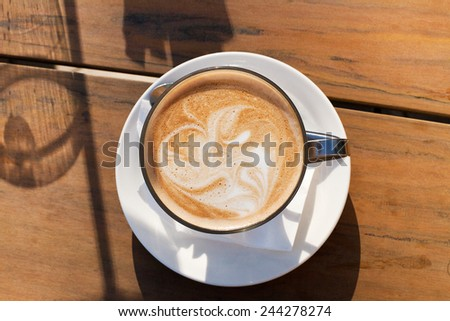 View from above a Cafe Latte drink on a coffee shop table - stock photo