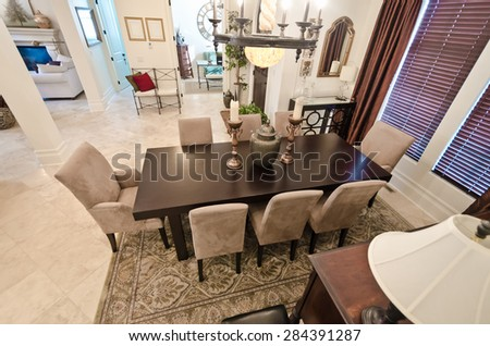 View from above at the luxury living suite: dining table (room) and the living room at the back. Interior design.