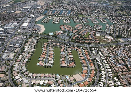 View from above of a man made lake housing community in the desert - stock photo