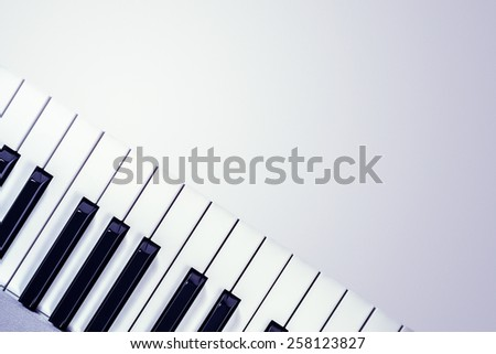 View from above of a synthesizer keyboard  isolated on a gradient gray background
