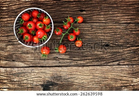 View from above of  baby tomato on wood - stock photo