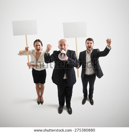 view from above of displeasure people on the meeting with empty white placards and megaphone over light grey background - stock photo