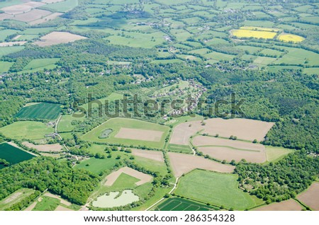 View from above of farmland in the Surrey Hills at the villages of Parkgate and Newdigate near Dorking. - stock photo