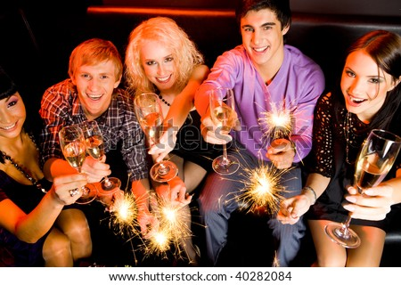 View from above of friendly company with champagne wishing you happy New Year - stock photo