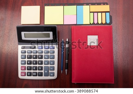 View from above of wooden organized office desk as planning and business accounting concept - stock photo