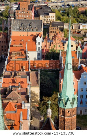 View from above over the Old Town of Gdansk in Poland, on the first plan Church of the Blessed Virgin Mary spire. - stock photo
