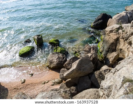 view from above seashore with rocks - stock photo