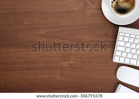 View from above with copy space, office table with notepad, keyboard and coffee cup.  - stock photo