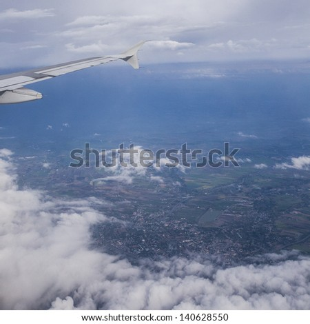 View from airplane on top of cloud