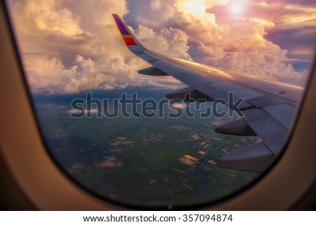 View from airplane window to see land from high angle - stock photo