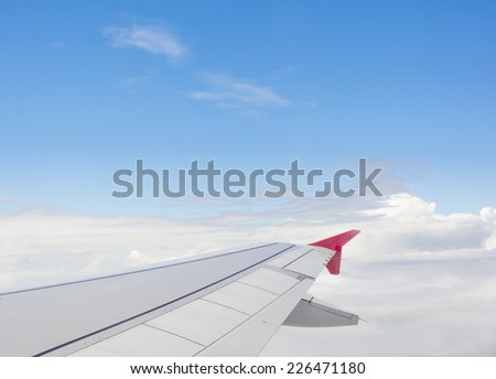 View from airplane window to see sky on day time. - stock photo