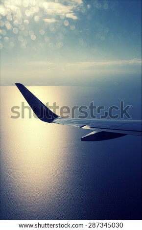 View from airplane window with blue sky and white clouds - stock photo