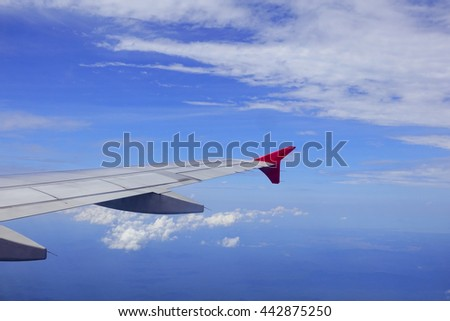 View from airplane window with blue sky and white clouds,select focus with shallow depth of field:ideal use for background. - stock photo