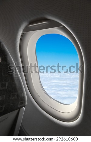 view from an airplane window at the sky - stock photo